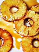 Grilled pineapple slices on a white background