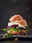 Beetroot burger with cream cheese, arugula, pine nuts and honey