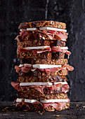 Stacked ham and camembert sandwiches