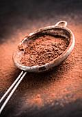 Chocolate powder in a sieve