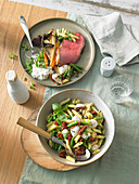 Mediterranean pasta salad and roast beef with roasted vegetables