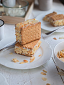 Biscuit slices with shortbread, cream and almonds