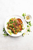 Eggplant steaks with pistachio and mint quinoa salad