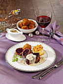 Beef fillet steak with red cabbage dumplings and potato gratin