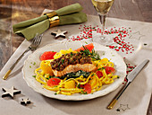 Salmon with a melba toast crust on a bed of tagliatelle