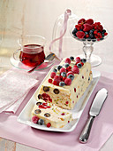 Cold dog with white chocolate and berries