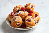 Raspberry muffins with powdered sugar