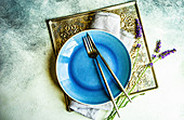 Summer time table set with minimalistic stoneware and cutlery decorated with fresh lavender flowers