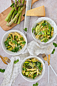 A healthy dinner pasta with green asparagus and zucchini