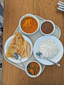 Rice, chapatis, beans, stew and coconut bananas (Zanzibar)