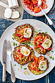 Courgette fritters with fried peppere and goat's cheese
