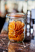 Dried orange slices in a mason jar