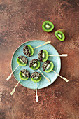 Kiwi on a stick dipped in chocolate