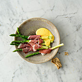 Green asparagus with cured ham and Hollandaise sauce