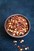 Chilli flakes in a wooden bowl