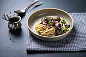Spaghetti with fried radicchio, mushrooms and peppers