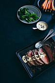 Whole roast sirloin with green peppercorn sauce