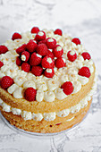 Biscuit cake with cream cheese and raspberries