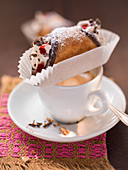 Cannoli on a coffee cup