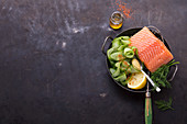 Ingredients for a salmon dish with cucumber