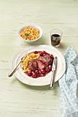 Fillet steak with cherry-red wine sauce and spaetzle