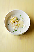 Asparagus and jasmine flower soup with ricotta and rice crepe