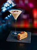 Cocktail and piece of cake