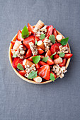 Strawberry and rhubarb tart with lime leaf brittle and puffed rice