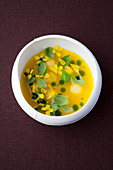Yellow watermelon gazpacho with basil oil