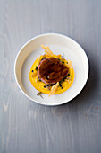 Lamb shoulder and braised coriander with passion fruit polenta