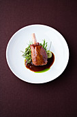 Lamb shanks and braised cardamom with hyssop and herb couscous