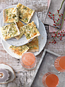 Zucchini cheese slices and pink grapefruit spritz