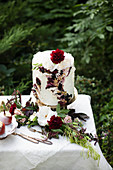 High cream cake with fruit jelly and gold leaf
