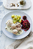 Königsberger Klopse (meatballs in a white sauce with capers) with salted potatoes and a beetroot salad
