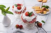 Vegan strawberry tiramisu with yoghurt cream in glasses
