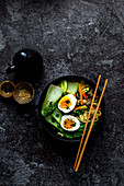 Noodle soup with carrots, mushrooms, pak choi, egg and sesame seeds (Asia)
