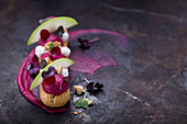 An eclair with beetroot, apple, goat's cheese and cress