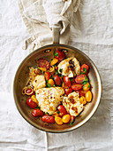 Roasted white fish with cherry tomatoes and lemon rind