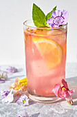 Edible flowers-Watermelon lemonade with flower ice cubes, mint and flower garnish