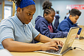 Teenagers learning to code