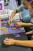 Teenagers building a circuit