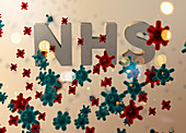 Viruses attacking NHS, conceptual illustration