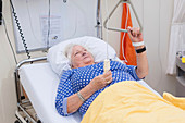 Hospital patient with hoist and alarm button