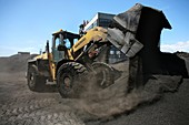 Digger moving coal