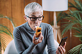 Senior woman using spirometer at home