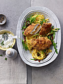 Chicken escalope with an orange and fennel crust with rocket and tagliatelle