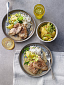 Creole chicken schnitzel with rice and celery and pineapple salad