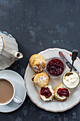 Scones with jam and clotted cream for tea