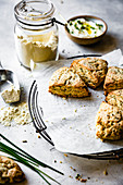 Cheese and herb scones beside a jar of oat flour