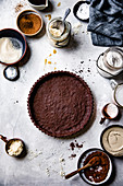 Chocolate tart crust with ingredients.